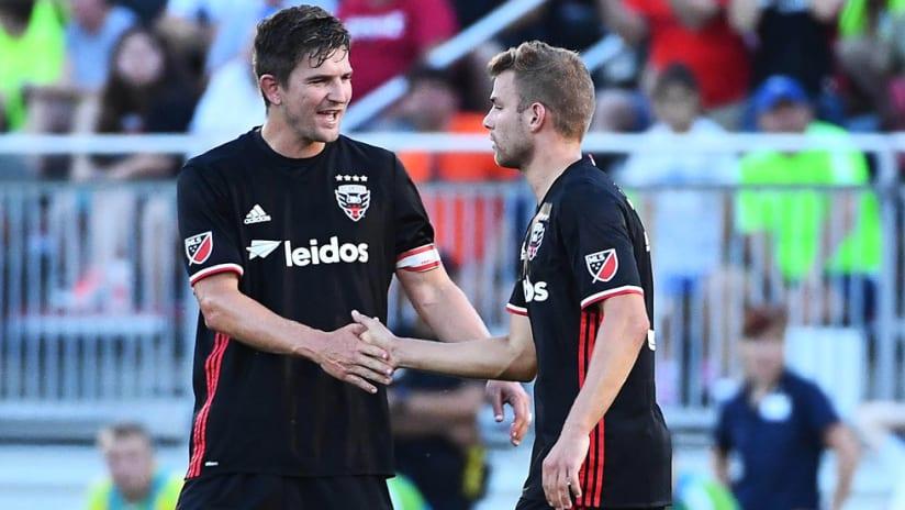 Bobby Boswell - DC United - congratulates Julian Buscher on a goal vs. Christos FC