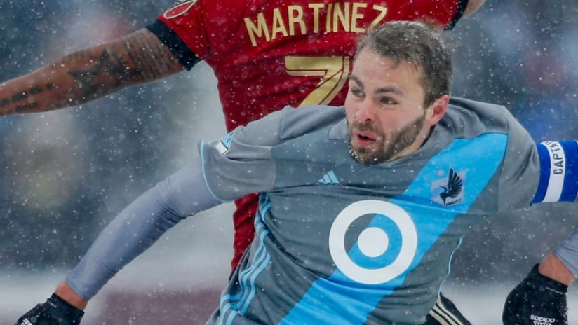 Vadim Demidov - Minnesota United - jumps for a ball in the snow