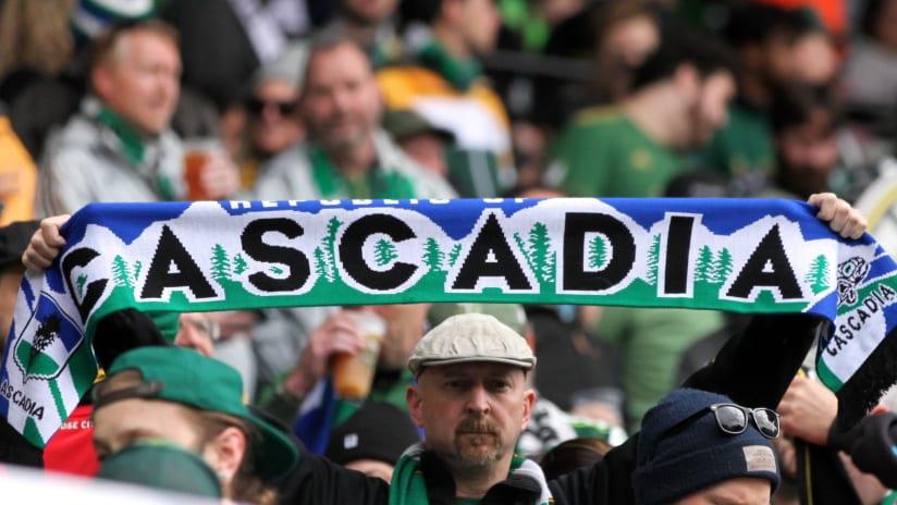 Cascadia scarf - held aloft by Portland Timbers fan