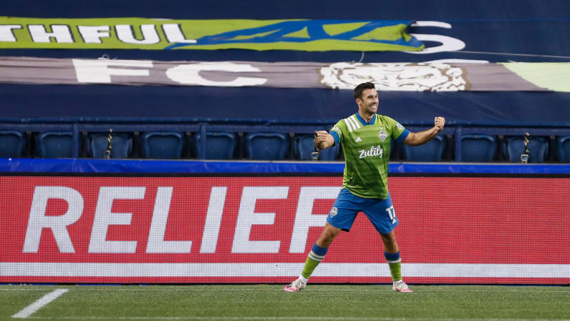 Will Bruin - Seattle Sounders - celebrates in front of tarped seats - for home-field advantage piece