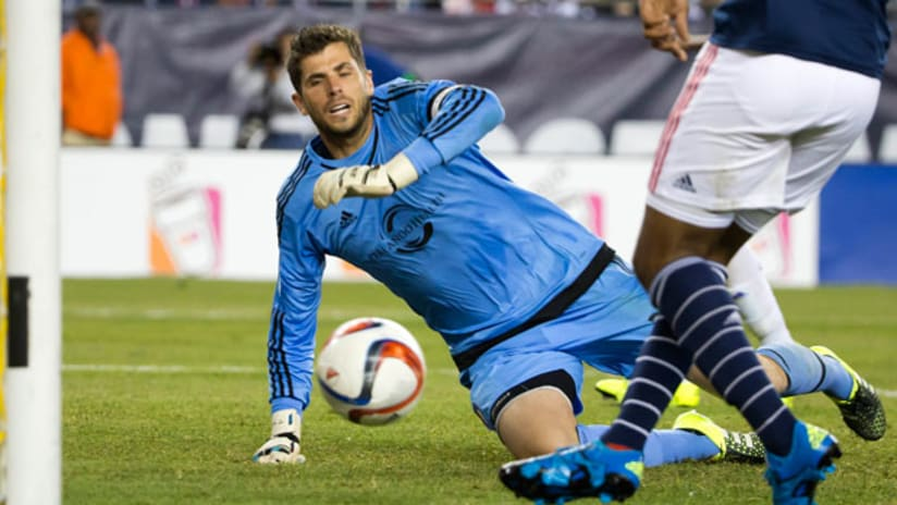 Orlando City FC goalkeeper Tally Hall watches the ball go into the back of the net