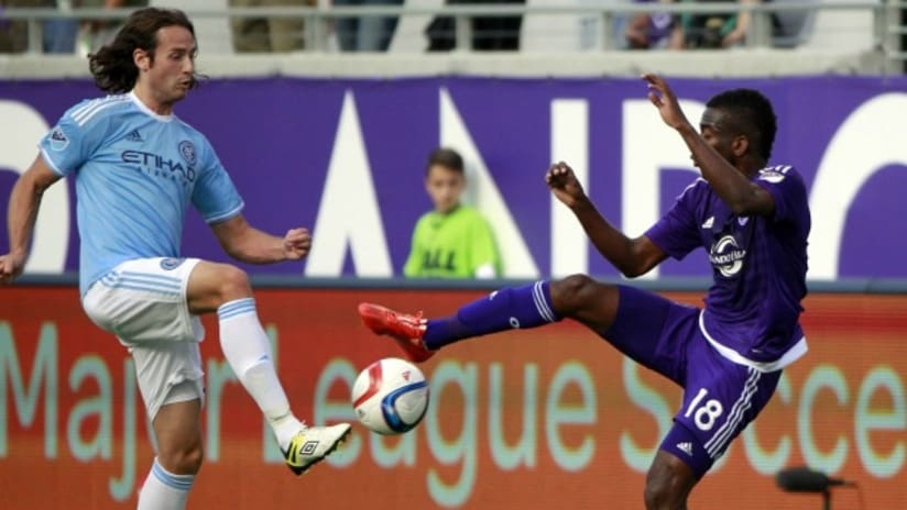 New York City FC's Mix Diskerud challenges Orlando City SC's Kevin Molino
