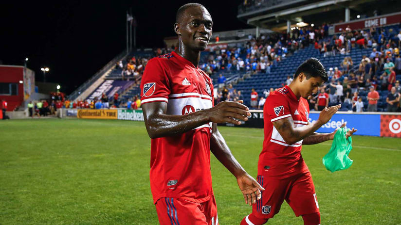 Micheal Azira - Chicago Fire - walks off the field - smiling