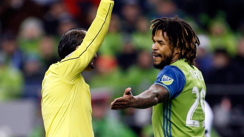 Roman Torres - show a yellow card - Seattle Sounders