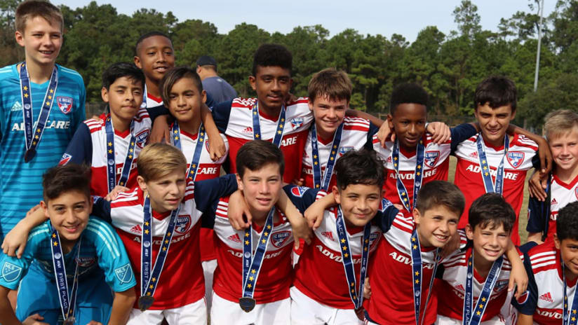 FC Dallas Under-13 academy team - coached by Javier Morales - with Copa Rayados trophy