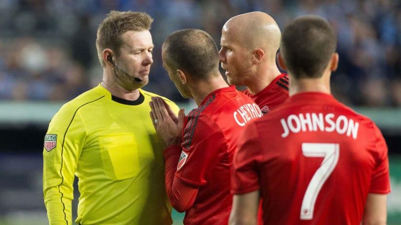 Benoit Cheyrou, Michael Bradley, Will Johnson - Toronto FC - Plead with referee Alan Kelly