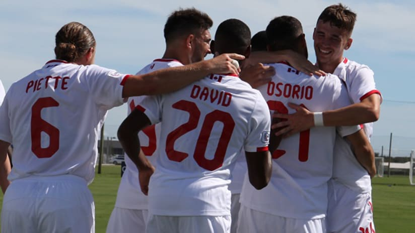 Canada national team - hugs after goal vs. US Virgin Islands