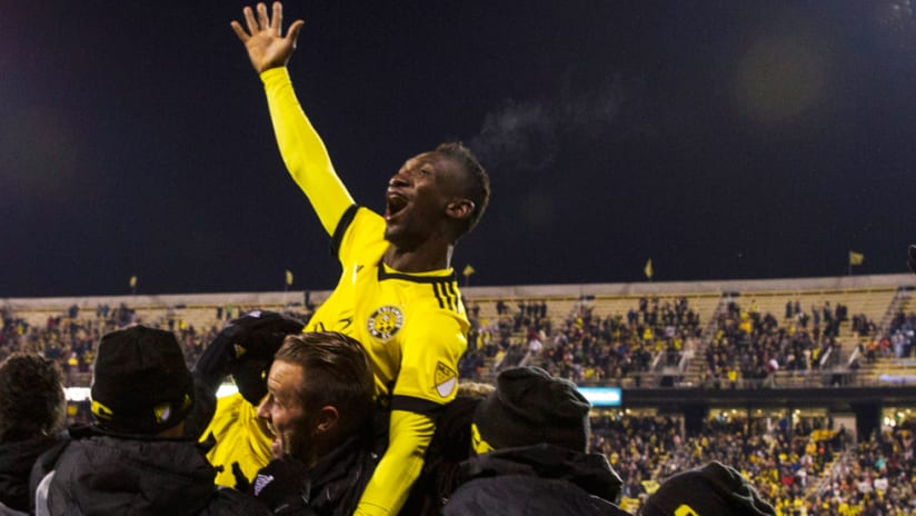 Harrison Afful - lifted by Crew SC players as he celebrates a goal vs. NYCFC