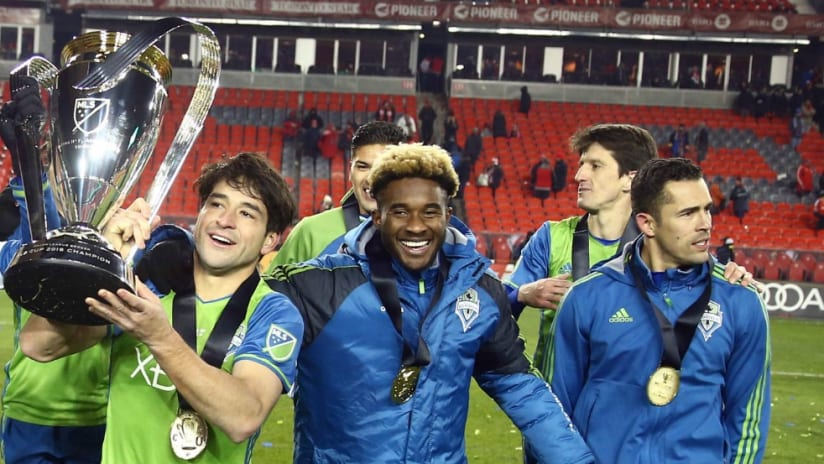 Nicolas Lodeiro - Seattle Sounders - carrying MLS Cup - teammates