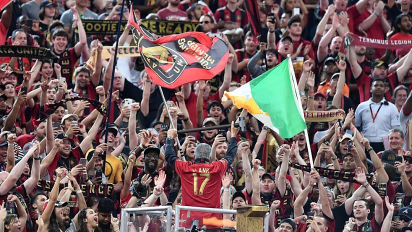 Arthur Blank leads the Atlanta fans, hammers golden spike - Atlanta United