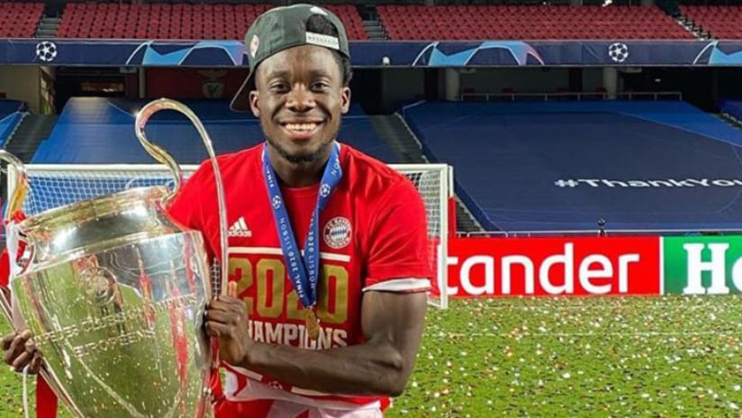 Alphonso Davies holds Champions League trophy