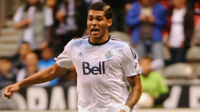 Christian Dean dribbles the ball against FC Edmonton (May 13, 2015)