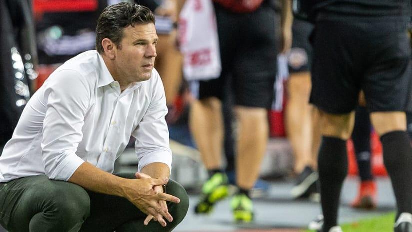 Greg Vanney - crouching on sideline - Toronto FC