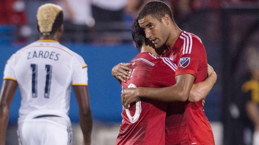 Tesho Akindele and Mauro Diaz - FC Dallas - celebrate a goal in 2015
