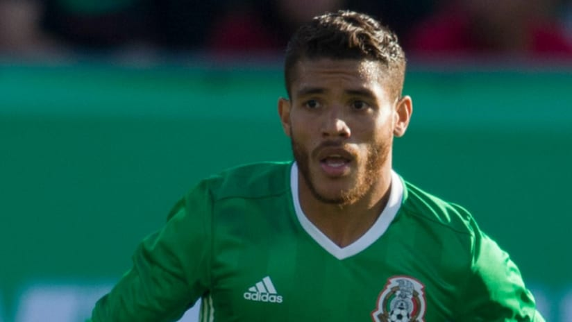 Jonathan dos Santos - Mexico - looks upfield while on the dribble