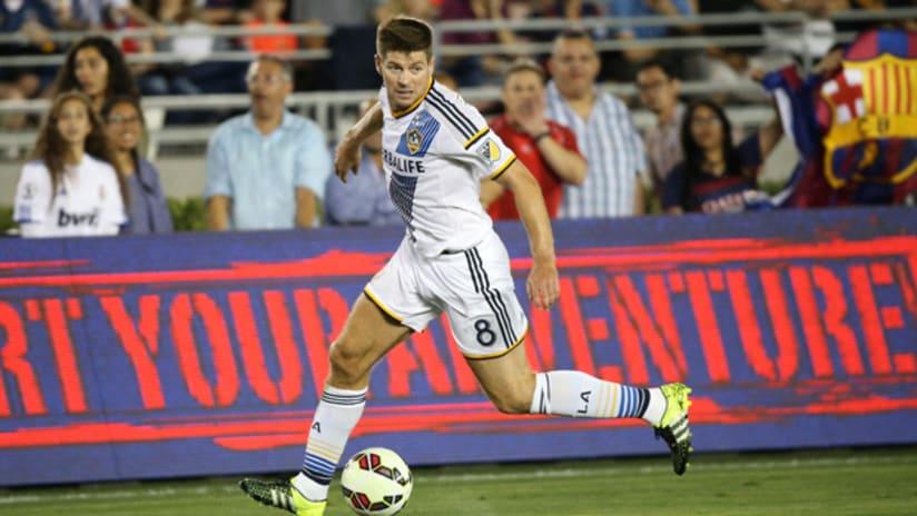 Steven Gerrard of the Los Angeles Galaxy controls a dribble