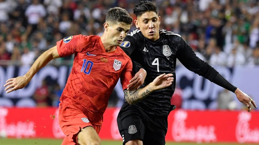 Christian Pulisic - United States - battles for the ball with Mexico's Edson Alvarez in the Gold Cup final