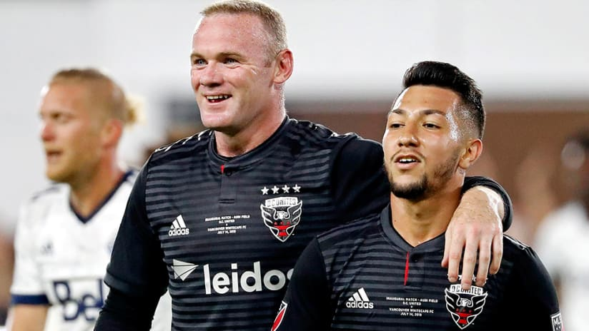 Wayne Rooney, Luciano Acosta - DC United - smiles, arm around after goal