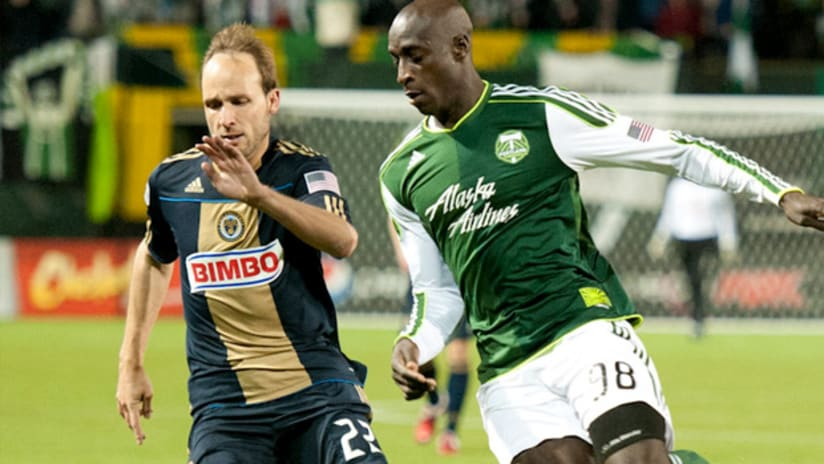 """Philadelphia's Justin Mapp (left) and Portland's Mamadou """"Futty"""" Danso chase down a ball."""