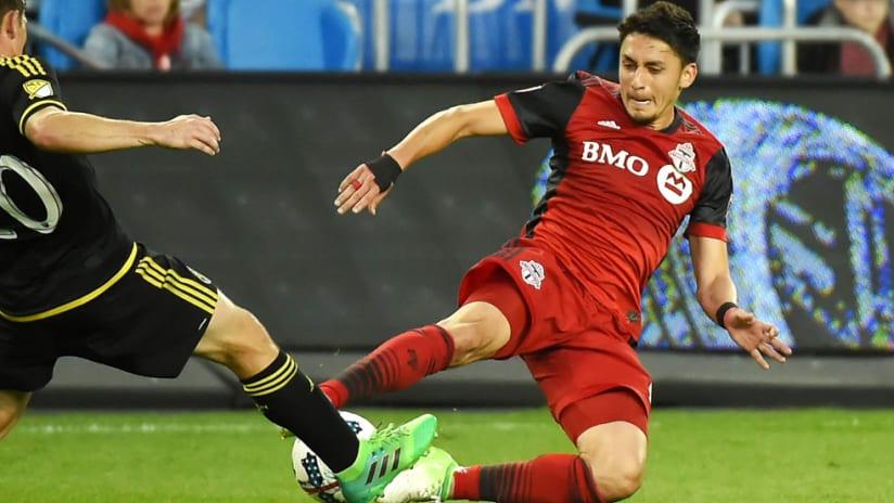 Marky Delgado - Toronto FC - Wil Trapp - Columbus Crew SC - contest a 50-50 ball
