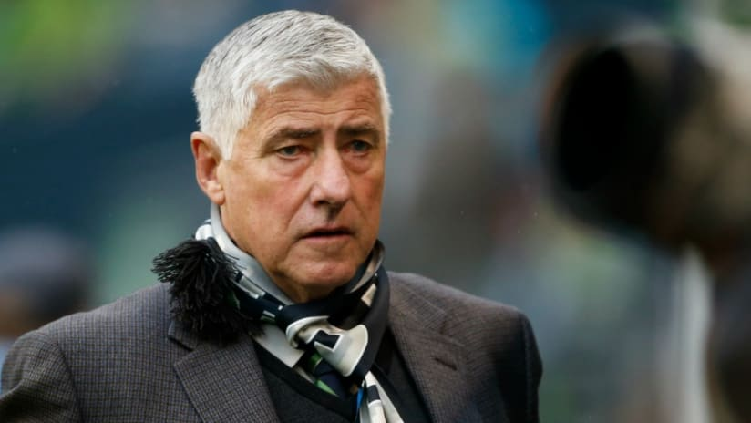 Sigi Schmid (Seattle Sounders) watches on during a game