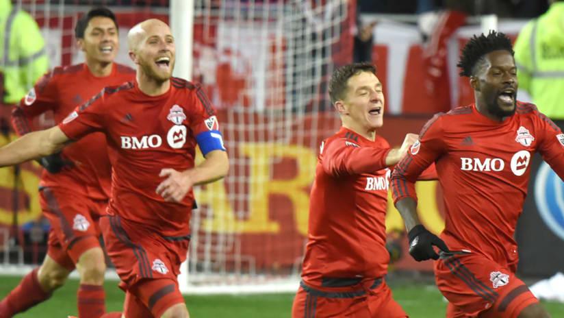 Tosaint Ricketts - Toronto FC - Happy Michael Bradley chasing to celebrate