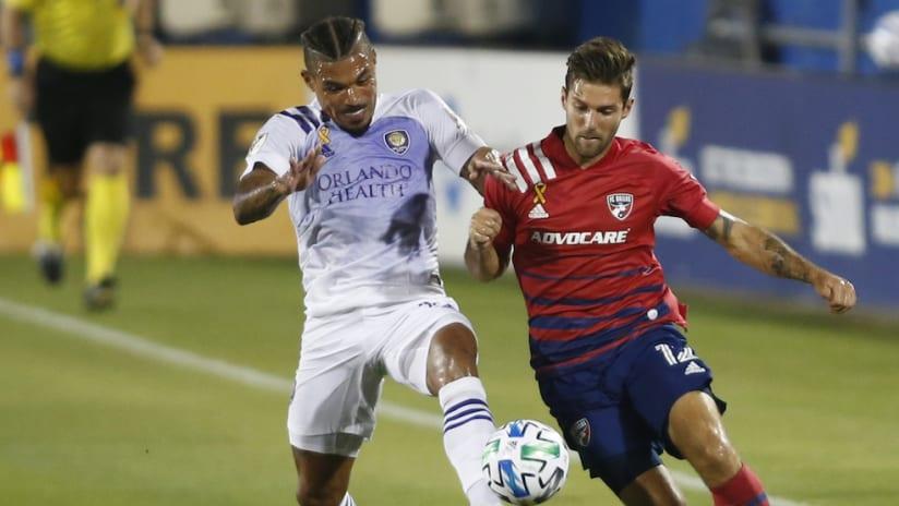 Junior Urso battles Ryan Hollingshead for the ball