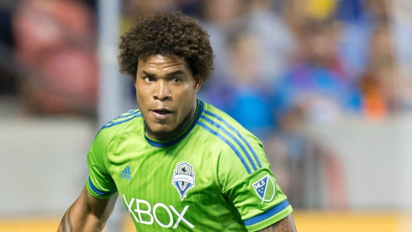 Roman Torres - Seattle Sounders - looks upfield to play a pass