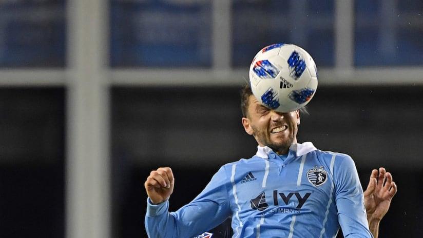Ilie Sanchez heads the ball