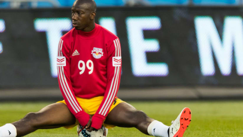 Bradley Wright-Phillips -- sits on ball -- warming up