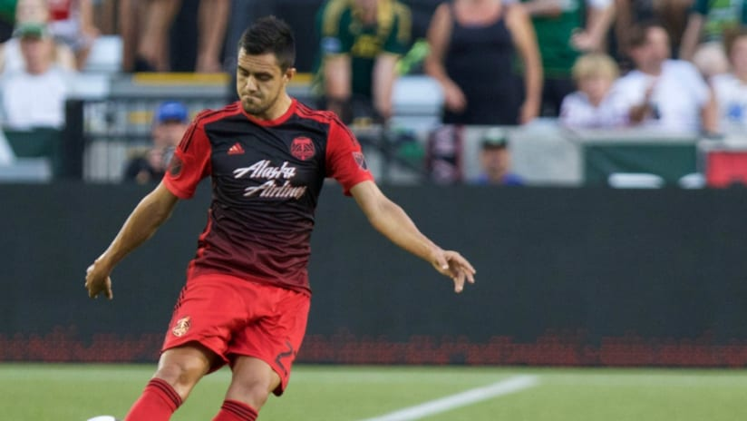 Norberto Paparatto - Portland Timbers - looks down to send a ball upfield
