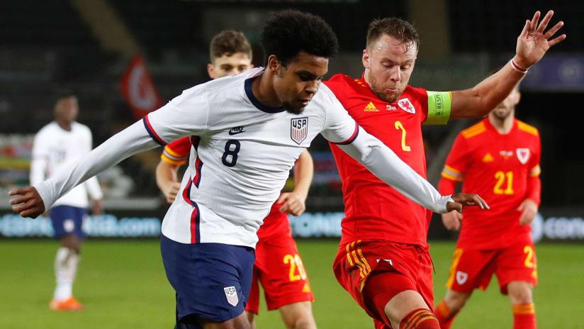 Weston McKennie - USMNT - United States - holds off a Wales player