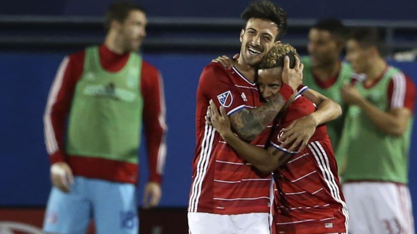 Maximiliano Urruti - Michael Barrios - celebrate a goal for FC Dallas