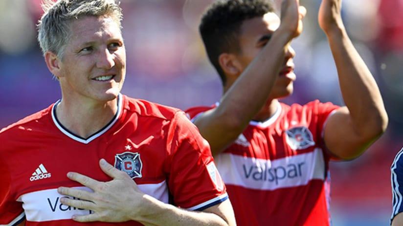 Bastian Schweinsteiger taps his heart