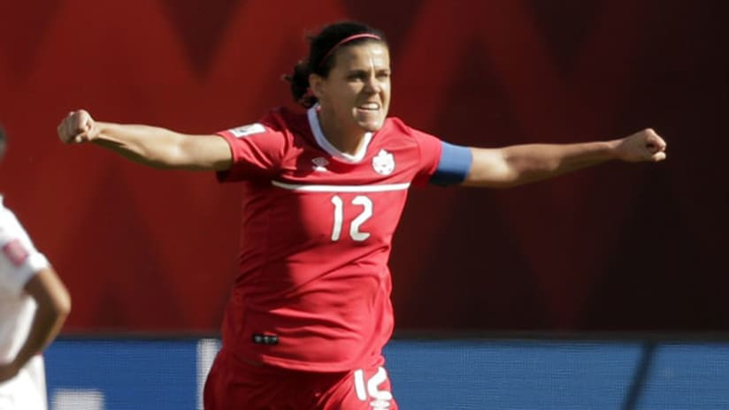 Christine Sinclair celebrates after scoring the winning PK vs. China