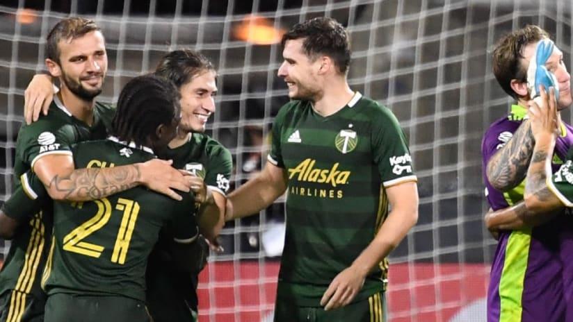 Jaroslaw Niezgoda - Portland teammates - Celebrate