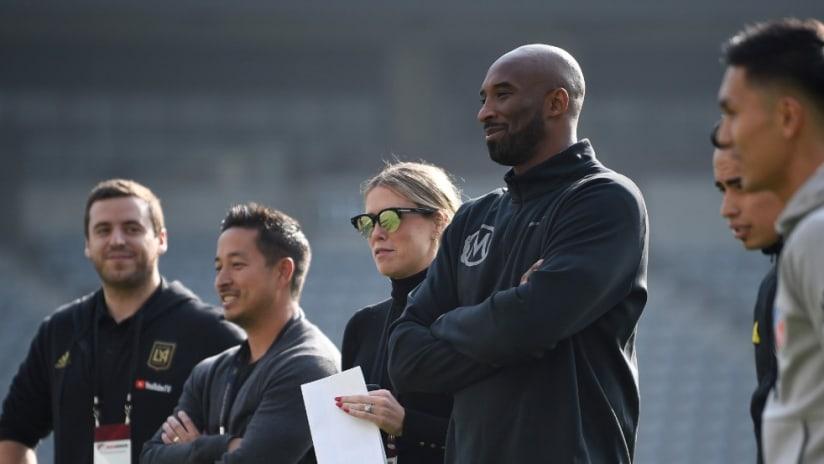 Kobe Bryant - stands listening - Banc of California stadium