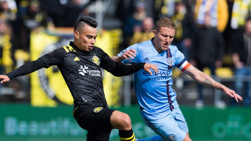 Lucas Zelarayan and Alex Ring battle for ball