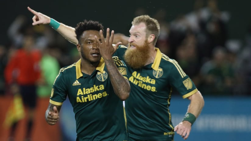 Rodney Wallace and Nat Borchers celebrate Wallace's goal, October 29, 2015