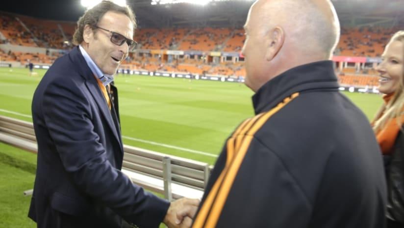 Houston Dynamo equity partner Gabriel Brener greets head coach Dominic Kinnear