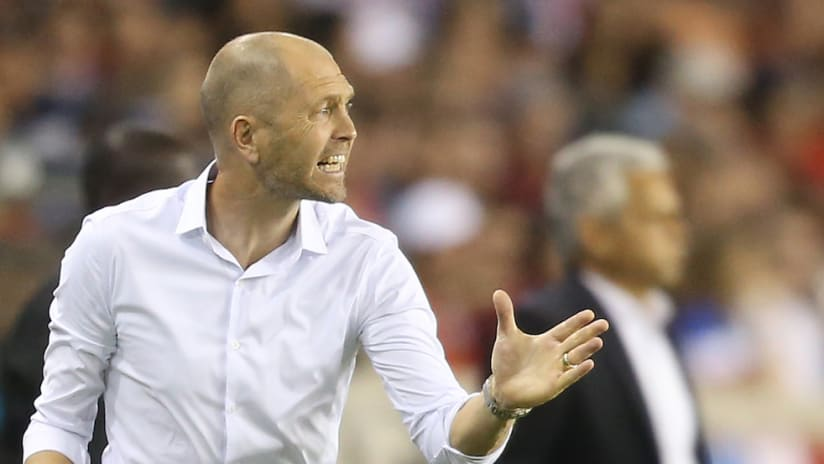 Gregg Berhalter gestures to his team vs. Chile