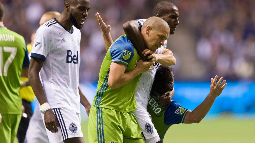 Aly Ghazal - Vancouver Whitecaps - apparent headlock on Alonso, Lodeiro