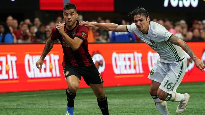 Portland Timbers Zarek Valentin and Atlanta United's Hector Villalba —June 24, 2018