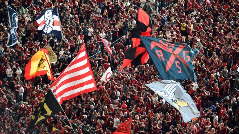 Atlanta fans - waving flags - ahead home opener vs. Cincinnati