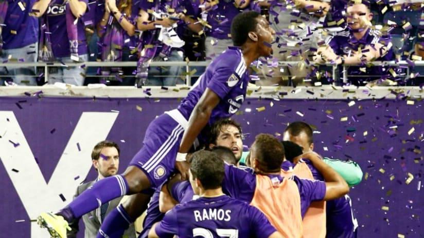 Orlando City players celebrate Aurelien Collin's late equalizer vs. the New England Revolution