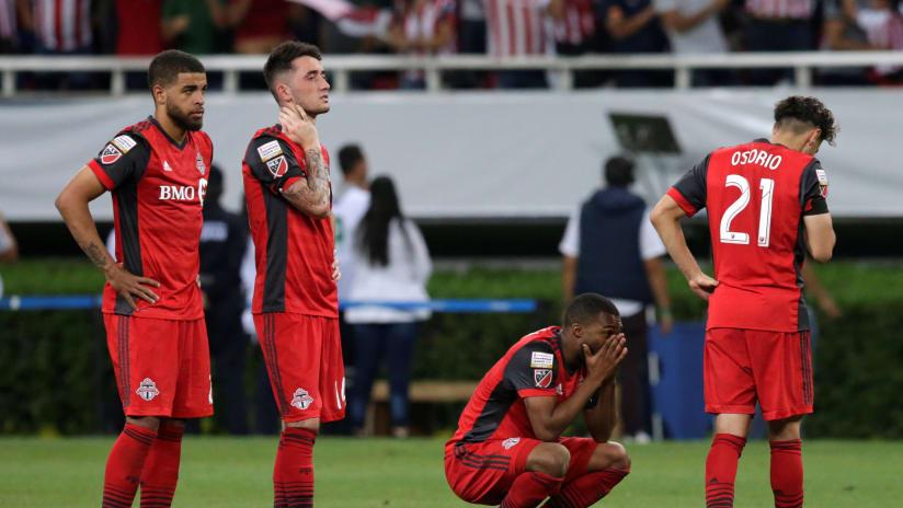 Jordan Hamilton, Jay Chapman, Ashtone Morgan, Jonathan Osorio - Toronto FC - dejected after CCL final