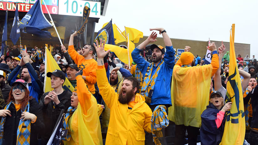 Nashville SC supporters - with flags at first-ever game, in the rain