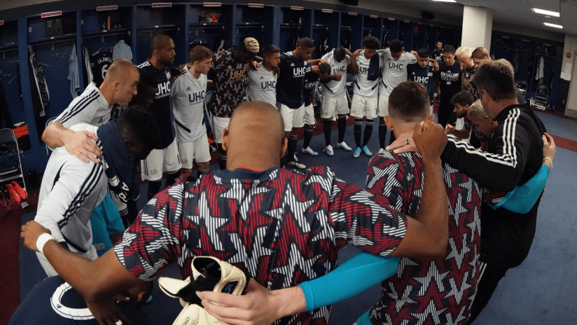 Group huddle locker room 2019