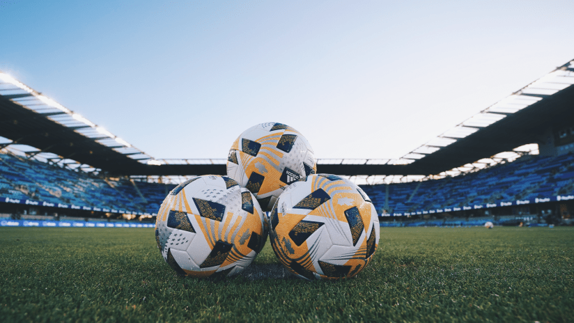 matias announcement - stacked soccer balls