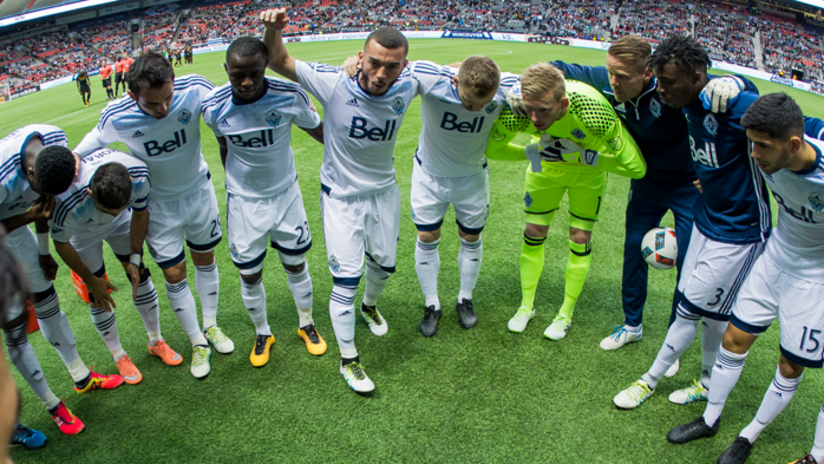 Pre-match huddle - white jersey